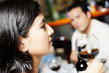 image of woman drinking wine disappears from page
